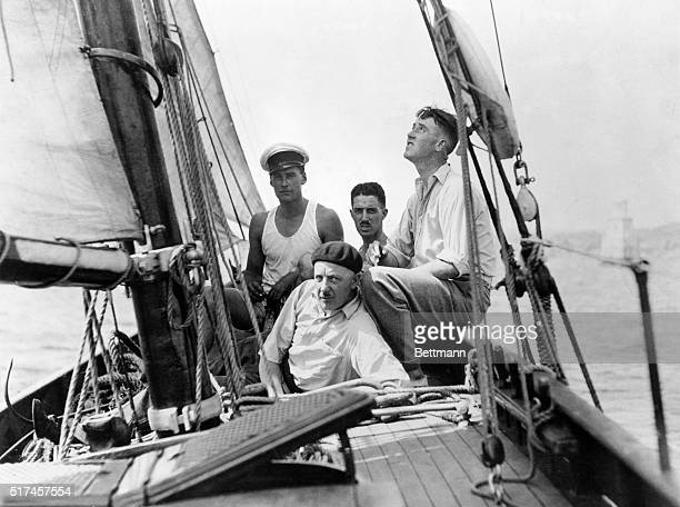 Actor/adventurer Error Flynn at the wheel on board the schooner Maski bound for Rabaul New Guinea The three other men are unidentified