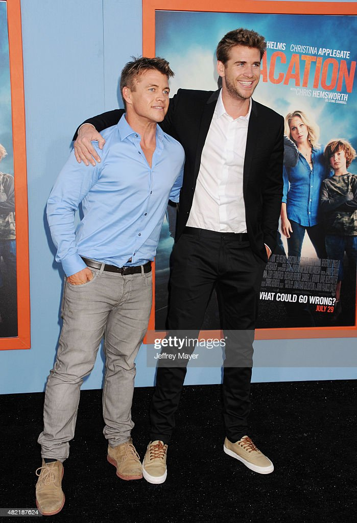 Actor/brothers Luke Hemsworth (L) and Liam Hemsworth arrive at the Premiere Of Warner Bros. 'Vacation' at Regency Village Theatre on July 27, 2015 in Westwood, California.