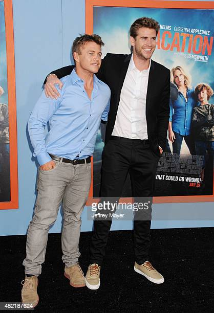 Actor/brothers Luke Hemsworth and Liam Hemsworth arrive at the Premiere Of Warner Bros 'Vacation' at Regency Village Theatre on July 27 2015 in...