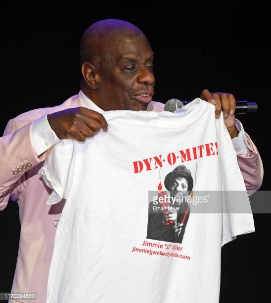 """Actor/comedian and host Jimmie """"JJ"""" Walker holds up a T-Shirt with his catchphrase """"Dy-no-mite!"""" from the television show """"Good Times"""" as he performs..."""