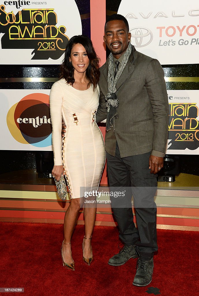 Actor/comedian Bill Bellamy (R) and Kristen Baker Bellamy attend the Soul Train Awards 2013 at the Orleans Arena on November 8, 2013 in Las Vegas, Nevada.
