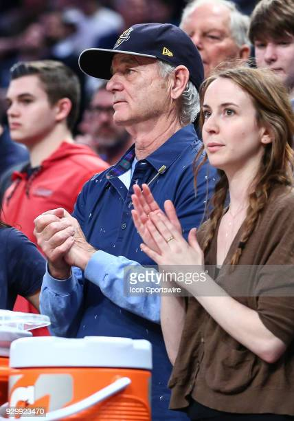 Actor/Comedian Bill Murray whose son Luke is an assistant coach for the team cheers on Xavier during the final minutes of the Mens College Basketball...