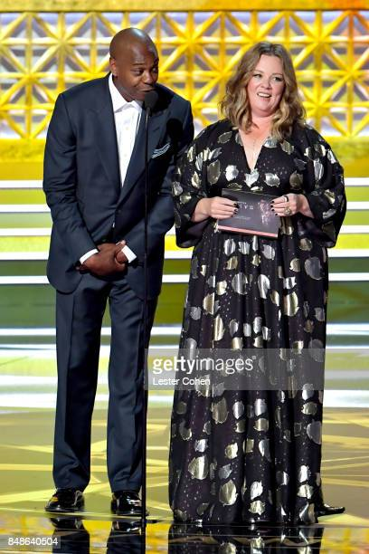 Actorcomedian Dave Chappelle and actor Melissa McCarthy speak onstage during the 69th Annual Primetime Emmy Awards at Microsoft Theater on September...