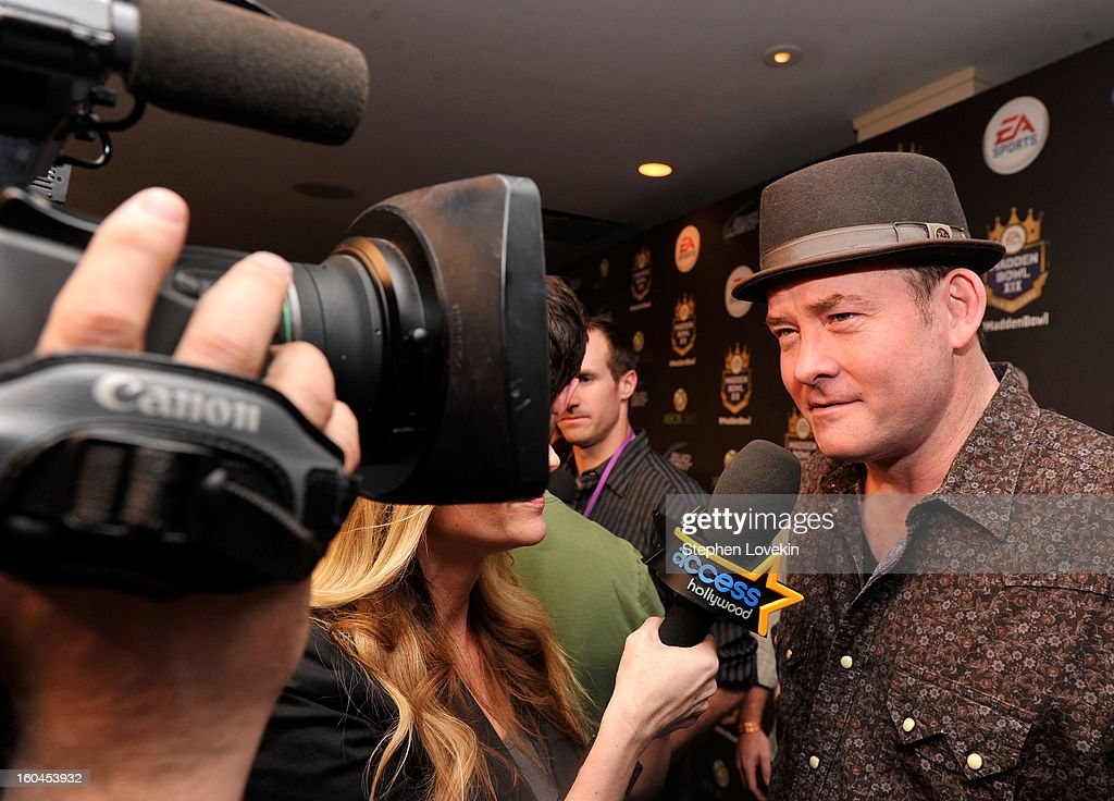Actor/comedian David Koechner arrives at EA SPORTS Madden Bowl XIX at the Bud Light Hotel on January 31, 2013 in New Orleans, Louisiana.