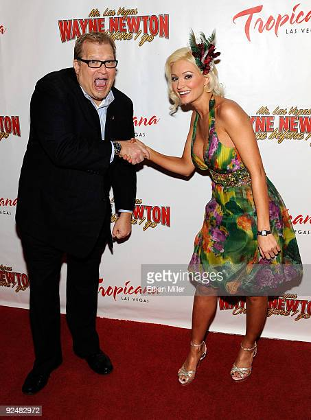 Actor/comedian Drew Carey and television personality and model Holly Madison arrive at the opening of Wayne Newton's limitedengagement production...