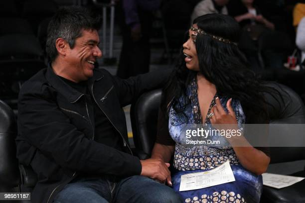Actor/comedian George Lopez talks with Pam Bryant, the mother of Kobe Bryant of the Los Angeles Lakers, before Game Two of the Western Conference...
