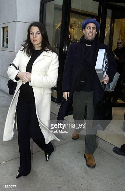 Actor/Comedian Jerry Seinfeld and his wife Jessica Sklar exit Barney's after shopping December 4 2002 in New York City