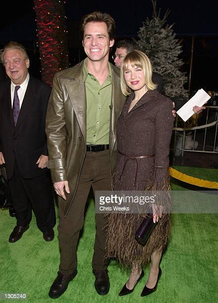 Actor/comedian Jim Carrey and girlfriend Renee Zellweger attend the premiere of Dr Seuss'' How The Grinch Stole Christmas November 8 2000 at...