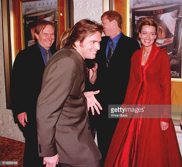 Actorcomedian Jim Carrey clowns around with cast members at the premiere of his new film The Truman Show 01 June in Westwood CA Carrey stars in the...