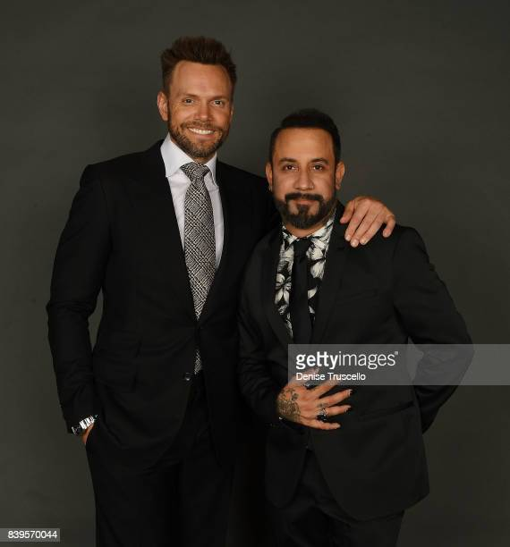 Actor/comedian Joel McHale and AJ McLean of the Backstreet Boys arrive at the live auction at the Tyler Robinson Foundation's 4th annual 'Believer...