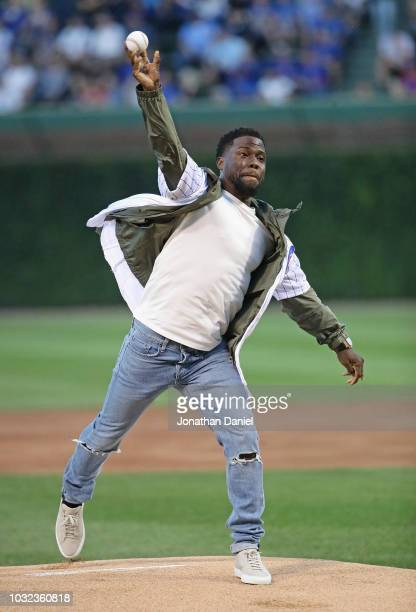 Actor/comedian Kevin Hart throws a ceremonial first pitch before the Chicago Cubs take on the Milwaukee Brewers at Wrigley Field on September 12 2018...