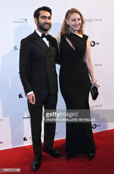 Actor/comedian Kumail Nanjiani and his wife writer Emily V Gordon pose on the red carpet for the 21st Annual Mark Twain Prize for American Humor at...