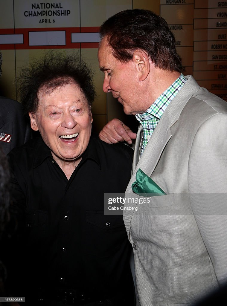 Actor/comedian Marty Allen (L) and impressionist Rich Little joke around during a meet and greet after Allen's performance at the Downtown Grand Hotel & Casino on March 23, 2015 in Las Vegas, Nevada.
