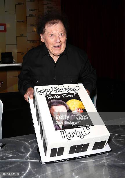 Actor/comedian Marty Allen holds up a cake to celebrate his 93rd birthday during a meet and greet after his performance at the Downtown Grand Hotel...