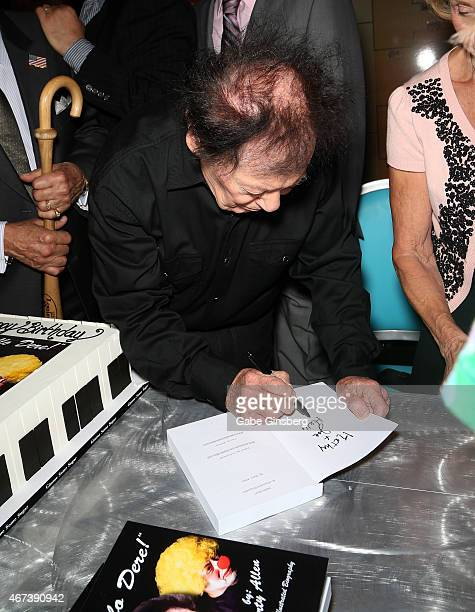 Actor/comedian Marty Allen signs a copy of his book 'Hello Dere An Illustrated Biography' during a meet and greet after his performance at the...