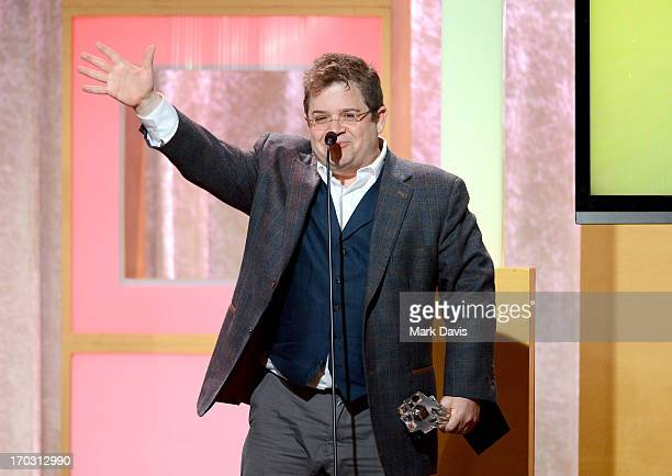 Actor/comedian Patton Oswalt accepts the award for Best Guest Performer in a Comedy Series onstage during Broadcast Television Journalists...
