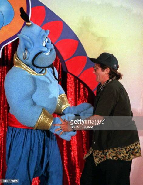 Actorcomedian Robin Williams dances 10 July in Los Angeles with the Disney character Genie during a celebration for the scheduled 13 August world...