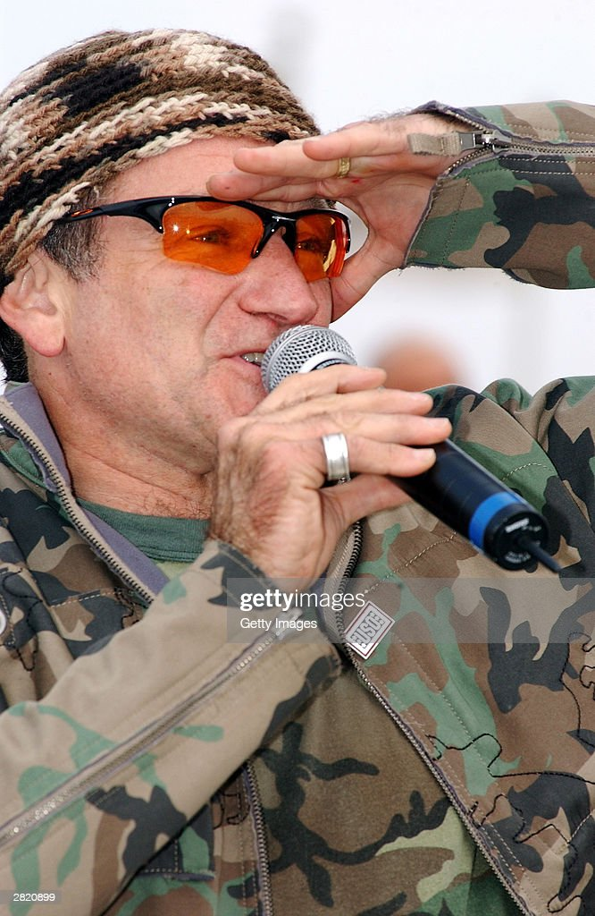 Actor/comedian Robin Williams entertains the troops during the United Service Organizations (USO) tour at Baghdad International Airport on December 16, 2003.
