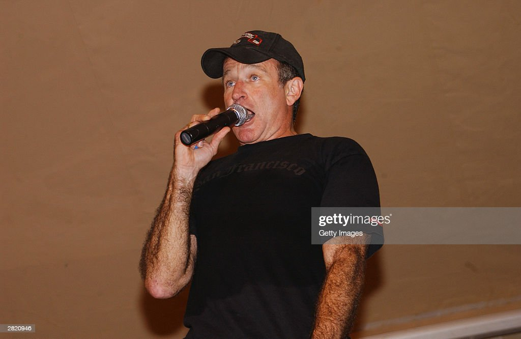 Actor/comedian Robin Williams entertains the troops during the United Service Organizations (USO) tour at Kirkuk Air Base on December 17, 2003.