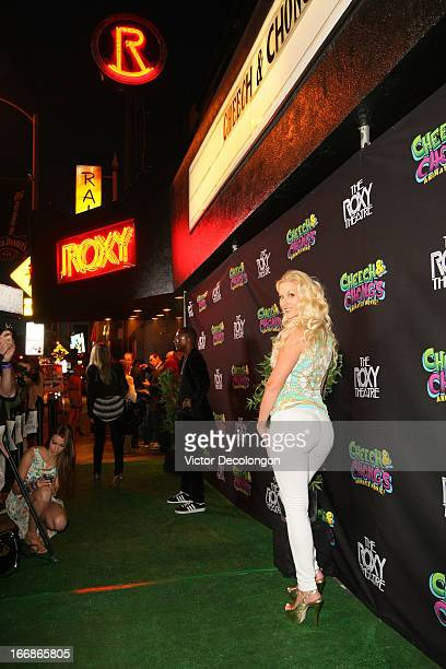 Actor/comedian Tommy Davidson and Amanda Moore attend the premiere of 'Cheech and Chong's Animated Movie' at The Roxy Theatre on April 17 2013 in...