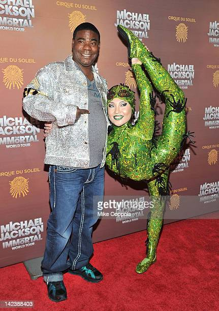 Actor/comedian Tracy Morgan poses for a picture with a Cirque du Soleil cast member for Michael Jackson the Immortal World Tour of at Madison Square...