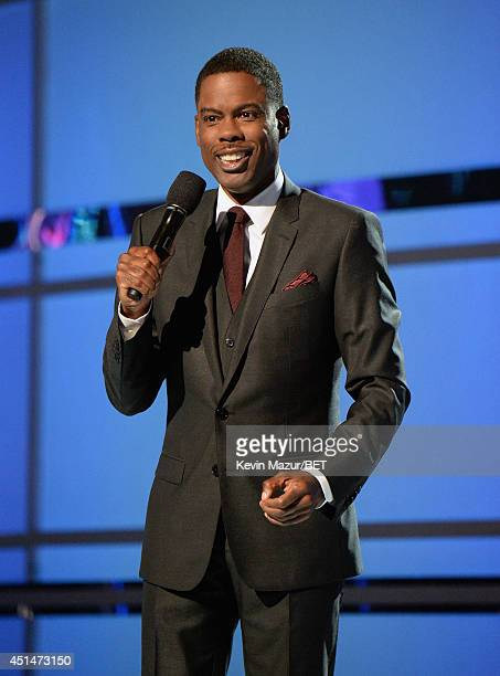 Actor/comedian/host Chris Rock speaks onstage during the BET AWARDS '14 at Nokia Theatre LA LIVE on June 29 2014 in Los Angeles California