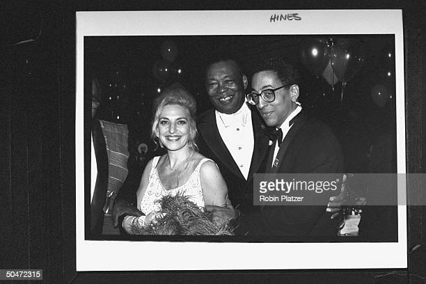 Actor/dancer Gregory Hines posing w producer wife Pamela Koslow his dad Maurice Hines Sr at Tony Awards party