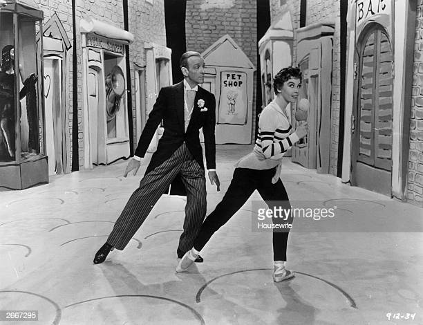 Actordancers Fred Astaire and Leslie Caron perform a dance number in the film 'Daddy Long Legs' directed by Jean Negulesco for 20th Century Fox