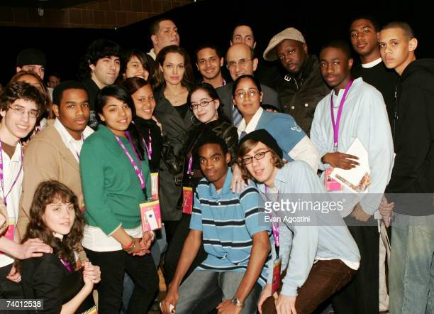 Actor/director Angelina Jolie Chancellor of the New York City Department of Education Joel Klein and recording artist Wyclef Jean pose with students...