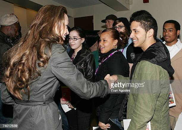 Actor/director Angelina Jolie greets students from Tribeca Film Institute's Film Fellows Program during the Tribeca Film Institute Screening of the...