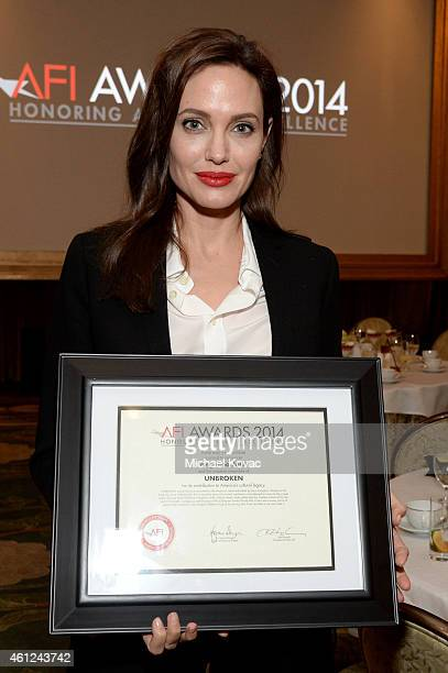 Actordirector Angelina Jolie poses with award during the 15th Annual AFI Awards Luncheon at Four Seasons Hotel Los Angeles at Beverly Hills on...
