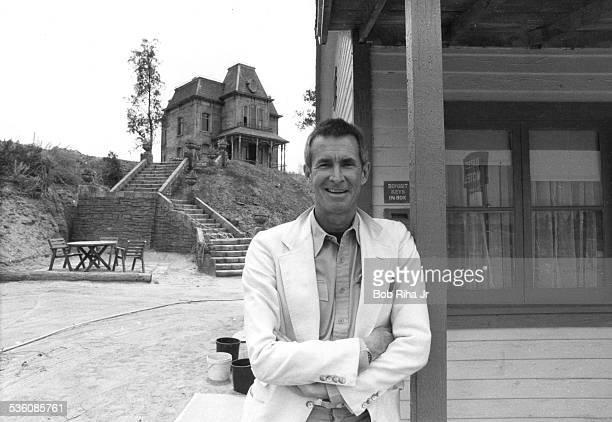 Actor/Director Anthony Perkins on the PSYCHO movie set at Universal Studios on June 24 1985 in Los Angeles California Perkins outside Bates Motel and...