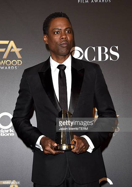 Actor/director Chris Rock winner of Hollywood Comedy Film for 'Top Five' poses in the press room during the 18th Annual Hollywood Film Awards at The...