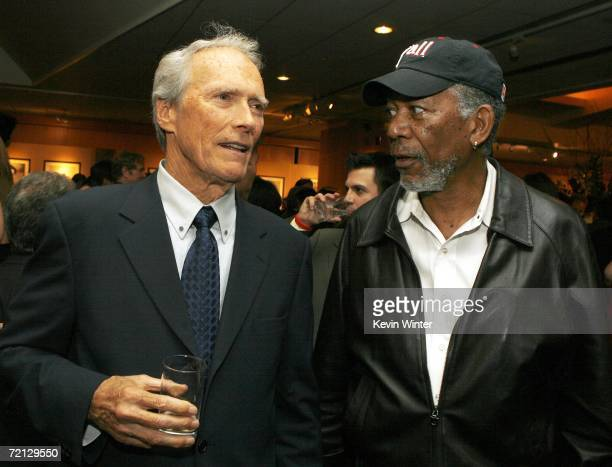 Actor/director Clint Eastwood and actor Morgan Freeman talk at the afterparty for the premiere of Paramount's 'Flags Of Our Fathers' at the Academy...