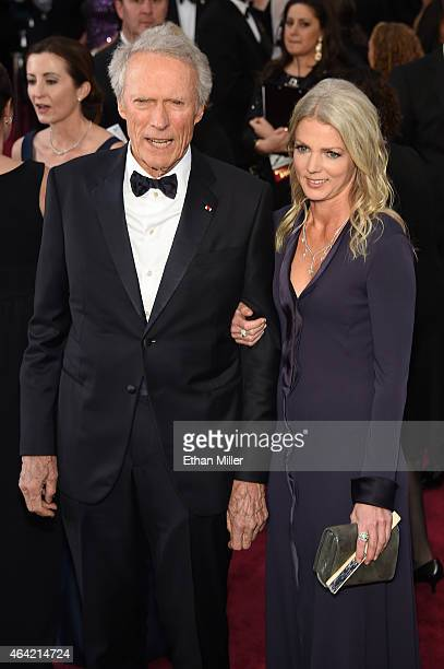 Actor/director Clint Eastwood and Christina Sandera attend the 87th Annual Academy Awards at Hollywood Highland Center on February 22 2015 in...