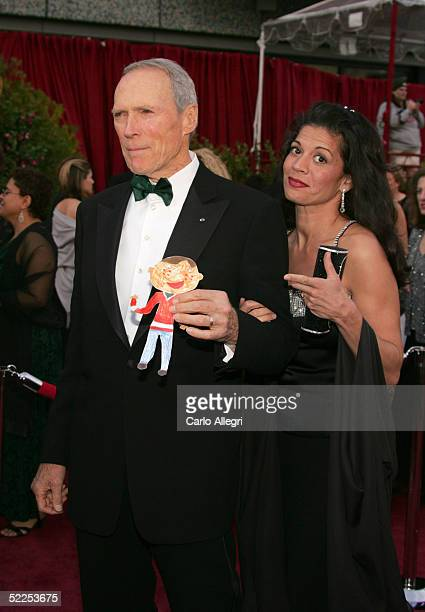 Actor/director Clint Eastwood and his wife Dina arrive at the 77th Annual Academy Awards at the Kodak Theater on February 27 2005 in Hollywood...
