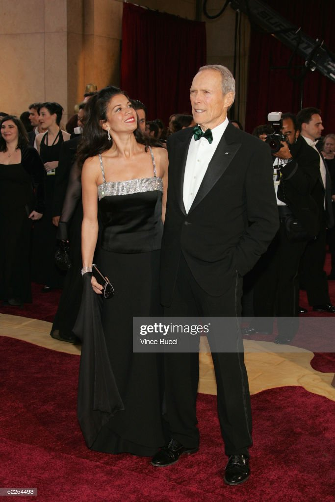 Actor/director Clint Eastwood and wife Dina Ruiz-Eastwood arrive at the 77th Annual Academy Awards at the Kodak Theater on February 27, 2005 in Hollywood, California.