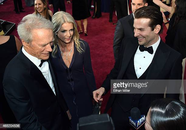 Actor/director Clint Eastwood Christina Sandera and actor Bradley Cooper attend the 87th Annual Academy Awards at Hollywood Highland Center on...