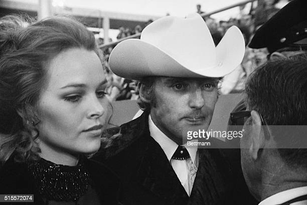 Actor-Director Dennis Hopper with fiancee Michelle Phillips shown as they arrived for the Academy Awards. April 7 Hollywood.