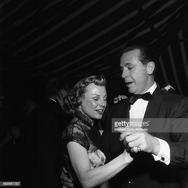 Actor/director Dick Powell and actress June Allyson attend the Richard Anderson and Carol Lee Ladd wedding in Los Angeles California