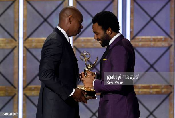 Actor/director Donald Glover accepts Outstanding Directing for a Comedy Series for 'Atlanta' from comedian Dave Chappelle onstage during the 69th...