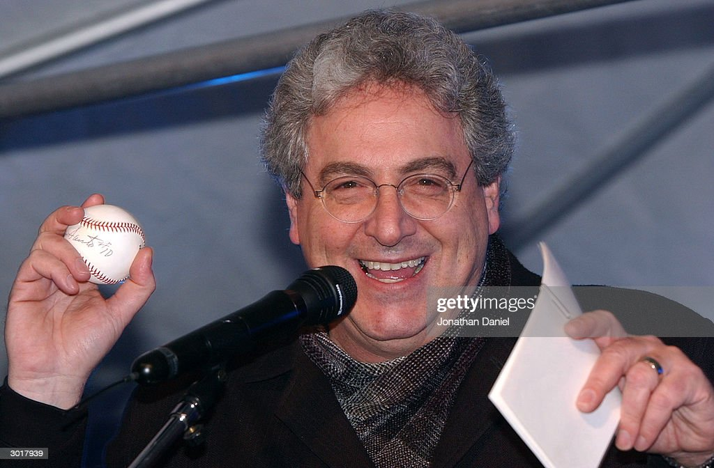 Actor/Director Harold Ramis emcees an auction to benefit the Juvenile Diabetes Research Foundation before the ceremony to destroy the cursed Chicago Cubs baseball on February 26, 2004 at Harry Caray's Restaurant in Chicago, Illinois. The alleged curse comes from a play during the NLCS where Luis Castillo of the Marlins hit a foul ball that Cubs fan Steve Bartman touched. This prevented Cubs' leftfielder Moises Alou from catching the ball which would have been the 2nd out of the 8th inning, instead the Marlins started a rally and went on to win the game, which forced a game 7 that the Marlins also won, on their way to becoming World Series Champs.