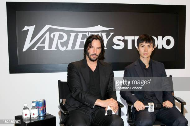 Actor/director Keanu Reeves and actor Tiger Chen attend the Variety Studio presented by Moroccanoil at Holt Renfrew during the 2013 Toronto...