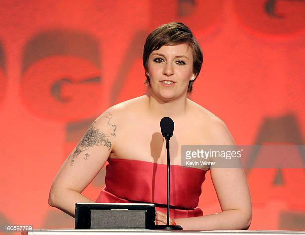 Actor/director Lena Dunham accepts the Outstanding Directorial Achievement in Comedy Series for 2012 award for 'Girls' onstage during the 65th Annual...