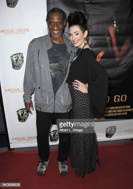 Actor/director Tim Russ and actress Adrienne Wilkinson arrive for the Los Angeles Premiere of 'Miles To Go' held at Writers Guild Theater on April 5...