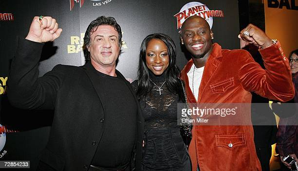 Actor/director/writer Sylvester Stallone Denise Boothe and her fiance boxer Antonio Tarver pose as they arrive at a party following the Las Vegas...