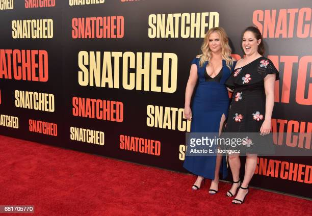 Actor/executive producer Amy Schumer and executive producer Kim Caramele attend the premiere of 20th Century Fox's Snatched at Regency Village...