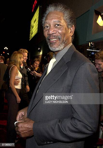 US actor/executive producer Morgan Freeman arrives at the premiere of his new film Under Suspicion as costar Thomas Jane is interviewed with his...