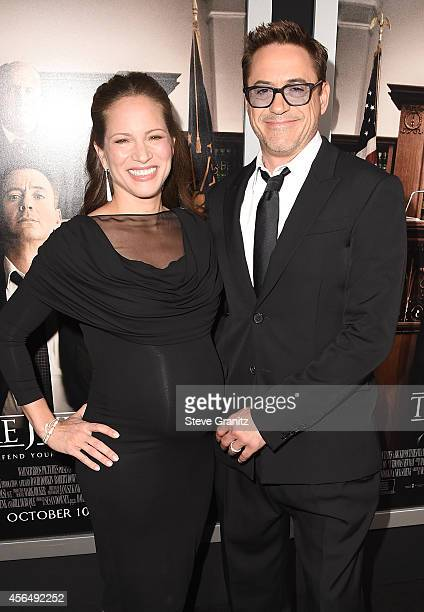 """Actor/Executive Producer Robert Downey Jr. And his wife Producer Susan Downey arrive for the Los Angeles premiere of """"The Judge"""" at AMPAS Samuel..."""
