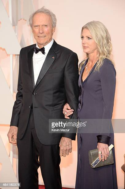 Actor/filmmaker Clint Eastwood and Christina Sandera attend the 87th Annual Academy Awards at Hollywood Highland Center on February 22 2015 in...